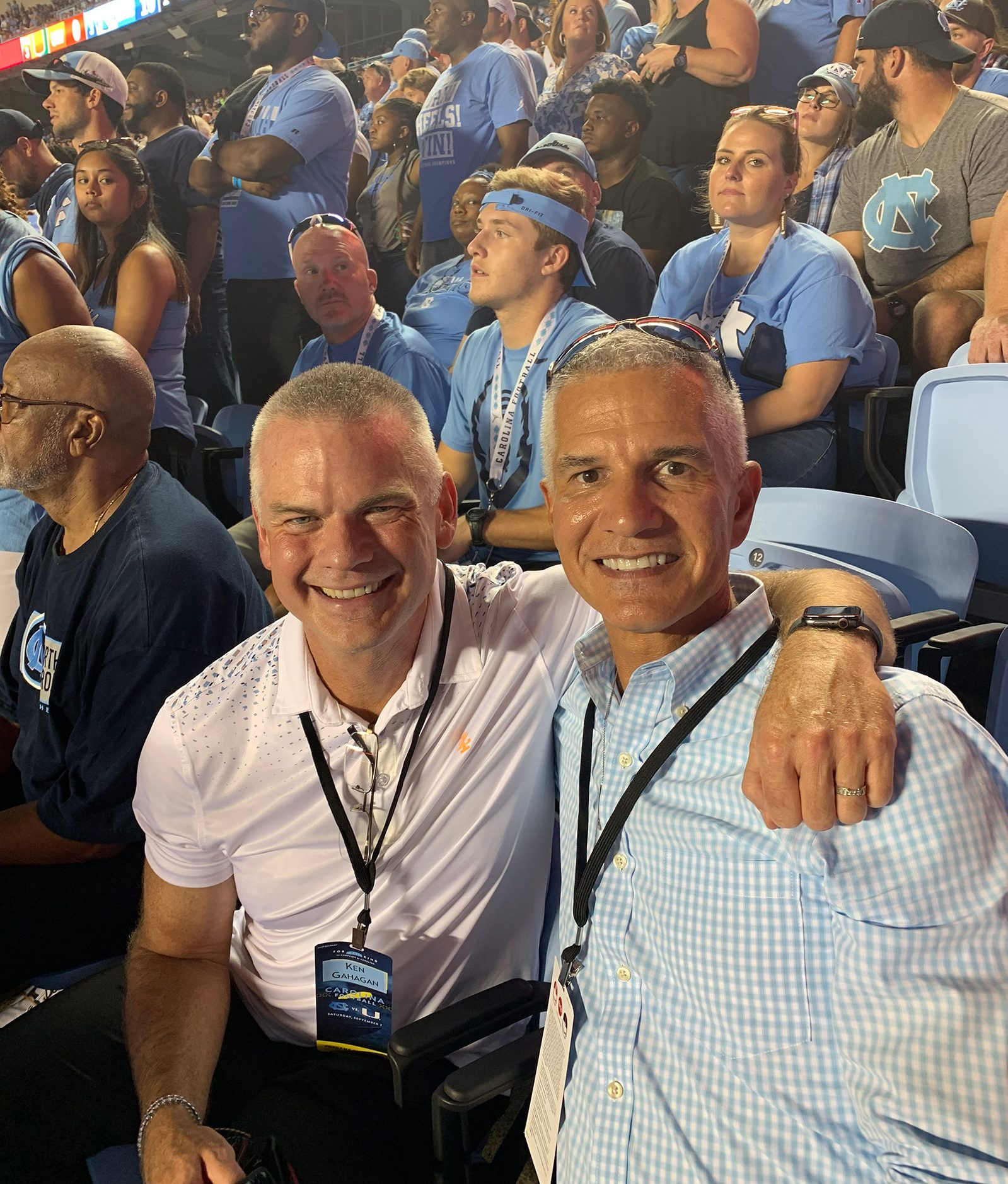 Kerry Bird and a friend at a basketball game in the Dean Dome.